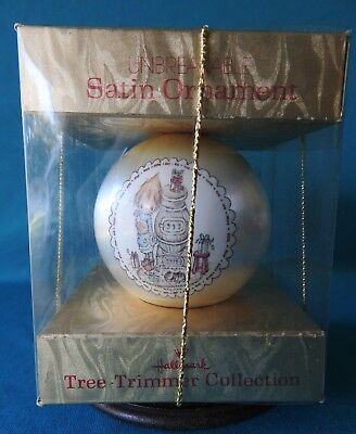 Hallmark Ornament 1976  Betsey Clark  At potbellied stove White Satin Ball 3""