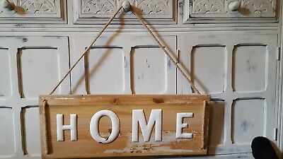 Old vintage 1950s enamel on copper letters HOME mounted on an old piece wood