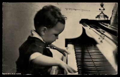 1930s vintage advertising piano Christmas child St Louis Postcard