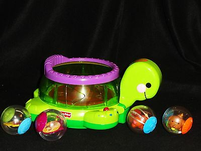 Fisher-Price Roll-A-Round  Spinning, Light-Up Turtle With Roll-A-Rounds