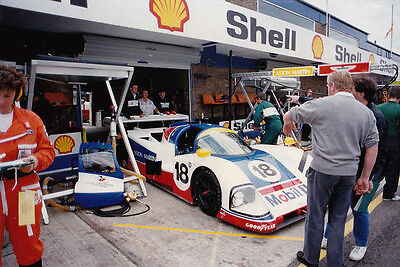 ASTON MARTIN SPORTS CARS No.18 IN PITS COLOUR PHOTOGRAPH.