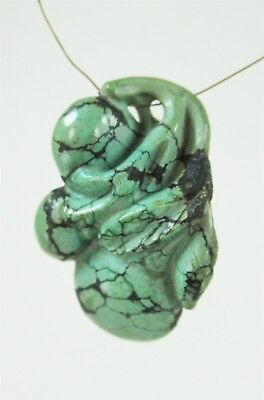 Carved Turquoise Nugget 1 1/2 inches by 1 Inch Drilled for Cord Chinese Asian