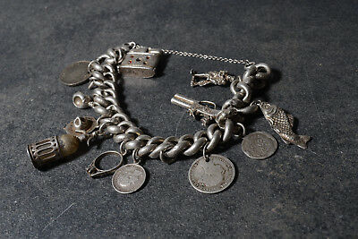 Hand made silver charm bracelet with 12 charms inc. sixpence 1887