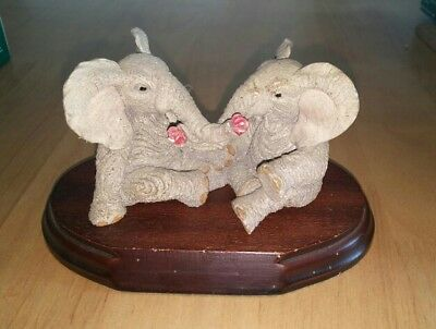 Tuskers Elephants Holding Roses Ornament On Wooden Stand