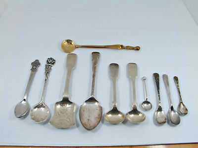 A JOB LOT of ELEVEN OLD PLATED SPOONS.