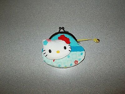 Adorable small sized 3 1/2 by 3 inch Sanrio Hello Kitty cloth coin purse used