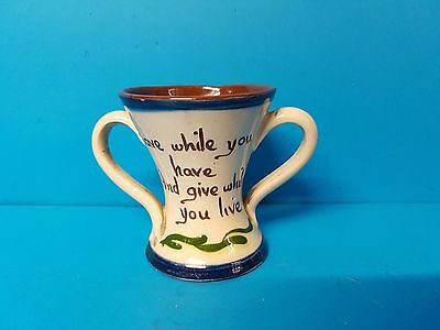 Save while you have and give while you live, two handle pot. Torquay Devon Motto