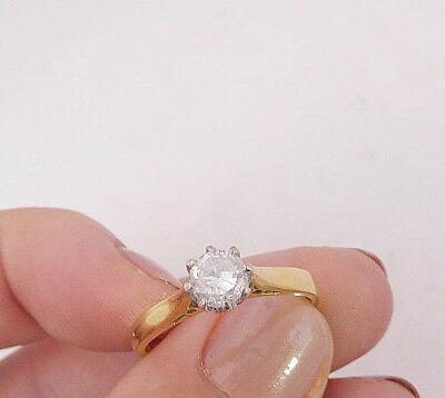 18ct/ 18k gold 63 point Diamond solitaire ring, 750