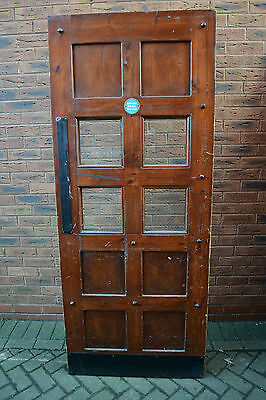 Solid wood custom made matching Courthouse style fire door.