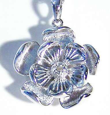 18 Inch Sterling Silver Chain With Captivating Diamond Accented Flower Pendant