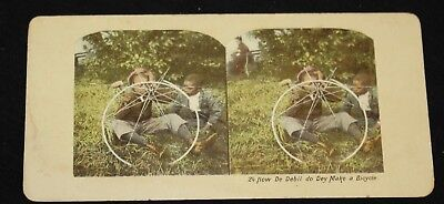 Two Black Boys attempting to make a Bicycle. Colored Stereoview. Number 24