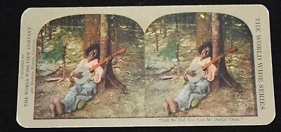 Young Black Man, playing Banjo, leaning by tree. Colored. World Wide View Co.