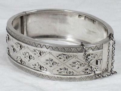 Victorian Sterling Silver Relief Decorated Hinged Bangle Bracelet dated 1899