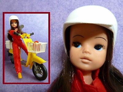 Vintage Sindy doll, with her yellow motorcycle , her red matching suit! Pedigree