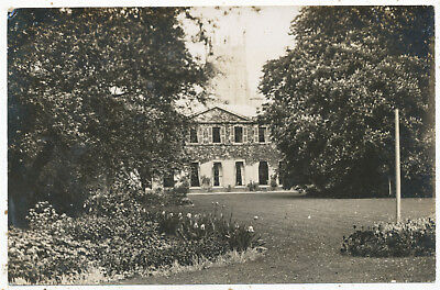 Unidentified grand house with church behind