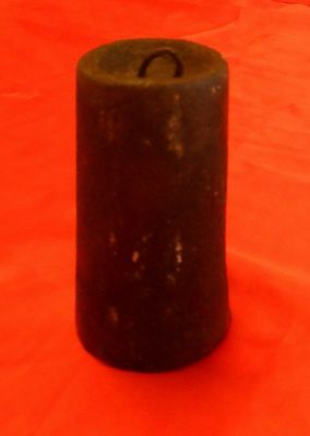 Old  Clock Weight in Cast Iron, 1.2kl.   9 cm High.  5 cm diameter at base.