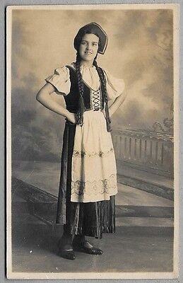 Edwardian/1920's era Postcard - Happy looking young lady wearing lovely costume