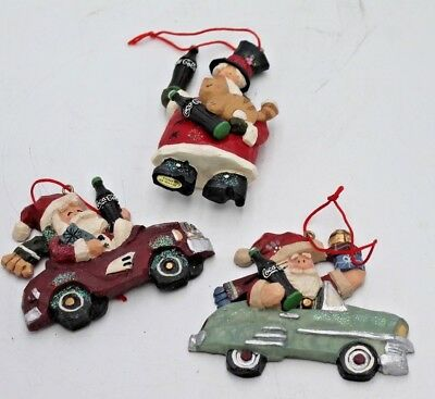 Three (3) Christmas Tree Ornaments Coca Cola Santa Driving Car 1998 +2000 Resin
