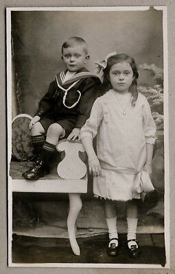 Edwardian Postcard - Beautifully dressed young girl and brother in sailor suit
