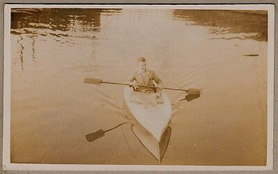 1930's era Postcard - Smartly dressed young man Kayaking on the water