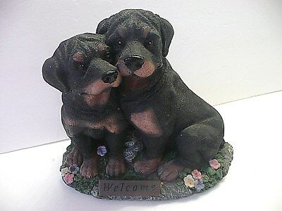 "Two Rottweiler dog figurines with a Welcome sign 8 1/2"" L x 7 1/2"" high"