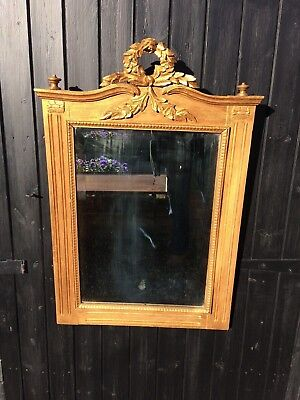 A French gilded wall mirror from around 1900
