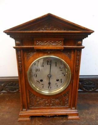carved walnut cased ting tang  bracket clock
