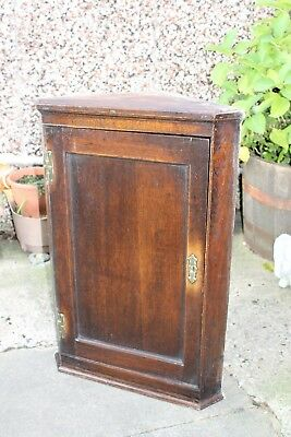 An antique  period corner cupboard in pitch pine with original fittings