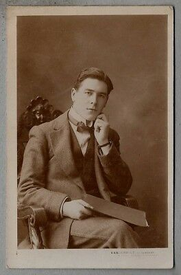 1910's era Postcard - Smartly dressed young man wearing a dickie bow and watch