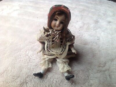 Antique vintage small bisque doll