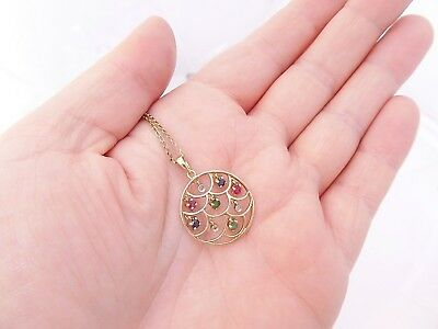 9ct gold Diamond, Ruby,Sapphire, Emerald multi gem stone pendant on 9k chain,375
