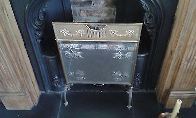 Antique Arts Crafts Deco firescreen. Brass with bevelled mirror with cut design