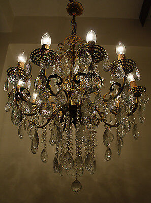 Antique 8 arms 8 lights Brass & Crystals Chandelier from 1950's
