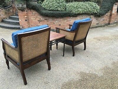 A Pair Of Antique Regency Style Mahogany Bergere Chairs With Suited Table