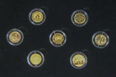 Beautiful Set of 7 Gold Coins in a Timber Presentation Case