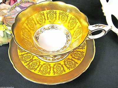 Royal Stafford Tea Cup And Saucer Raised Etch 24Kt Gold Gilt Yellow  Teacup