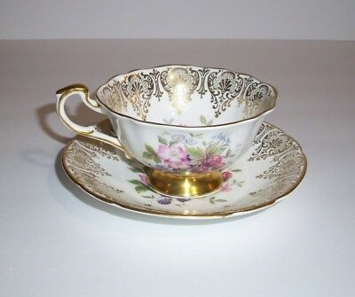 Light Blue and Gold with Floral Center Paragon Tea Cup and Saucer Set
