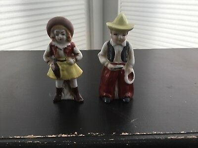 Vintage statues of cowboy and cowgirl made in occupied Japan