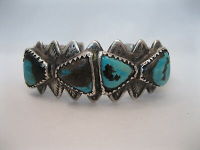 Lot 79 - Amazing 1920s Navajo Twisted Silver Wire Bracelet w 4 Turquoise Stones