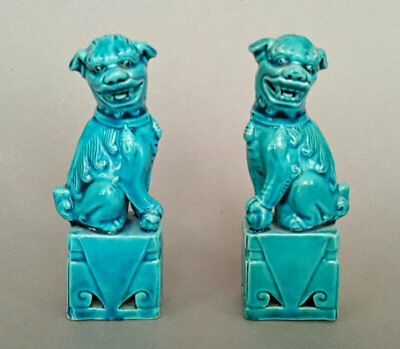 Pair of Chinese blue glazed Fu dog figurines, early 20th Century.