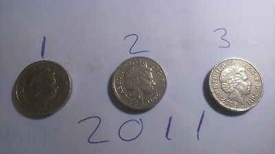 £1 ONE POUND BRITISH COIN..2011 ROYAL SHIELD ( good circulated condition