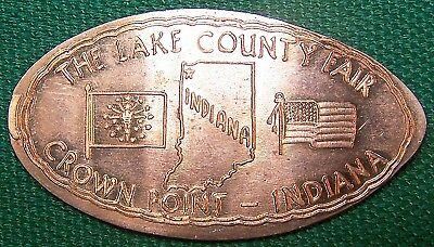 Elongated cent: THE LAKE COUNTY FAIR / CROWN POINT INDIANA (State Outline, Flag)