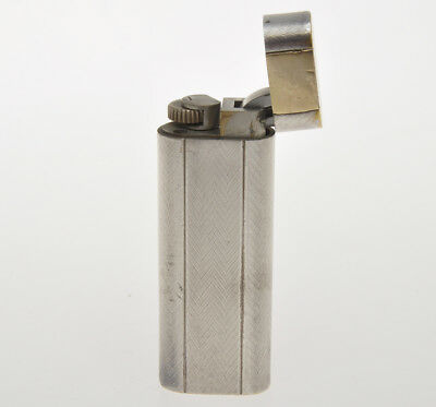 Cartier lighter with solid 18k gold inlay