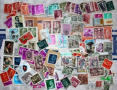Lot of mixed unsorted used SPAIN stamps some on paper