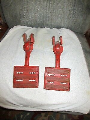 Pair Of Vintage Orange Colored Heavy Cast Iron Wagon/ Buggy Step