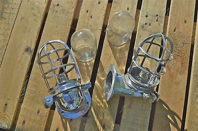 A pair of polished metal ocean liner ship bulk head lights wall lamps light