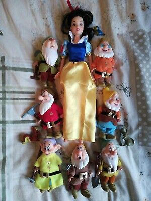 snow White doll and the seven dwarves