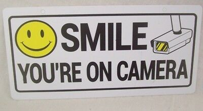 """NEW Store Fixture Supplies SMILE YOUR ON CAMERA SIGN 10"""" x 5"""" Plastic"""