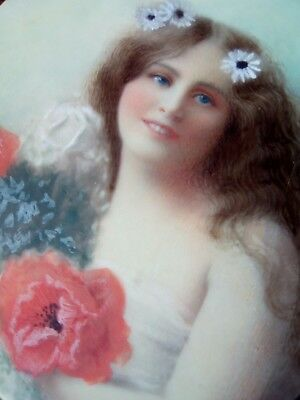Nineteenth century miniature painting of a young lady with flowers in her hair.