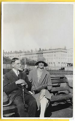 1930's era Postcard - Couple relaxing on a bench in Hastings